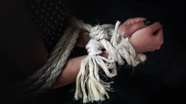 Midsection Of Woman Tied Up With Rope