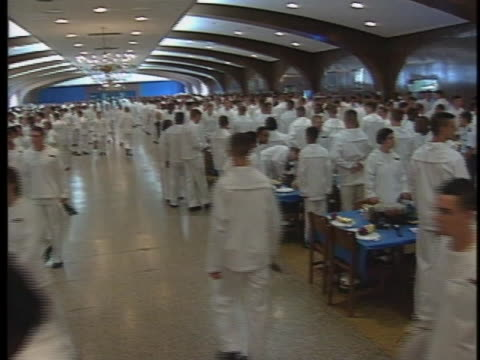 midshipmen and midshipwomen at the u.s. naval academy in annapolis, maryland, attend a banquet. - 士官候補生点の映像素材/bロール