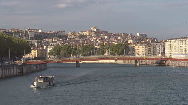 """Midshot - boat passing on the river Saône, backround hill Croix Rousse and bridge """" La Passerelle du Palais de Justice"""""""