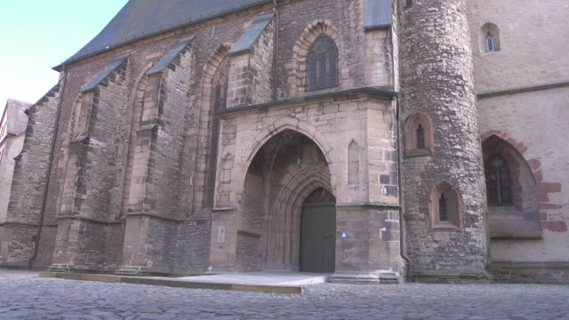 midshot of entrance of the st. petri pauli church in eisleben - christianity stock videos & royalty-free footage
