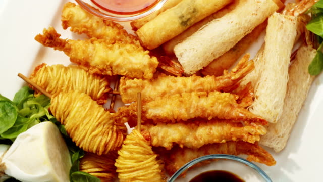 mid-shot of tempura appetisers on a plate with dips. - crustacean stock videos & royalty-free footage