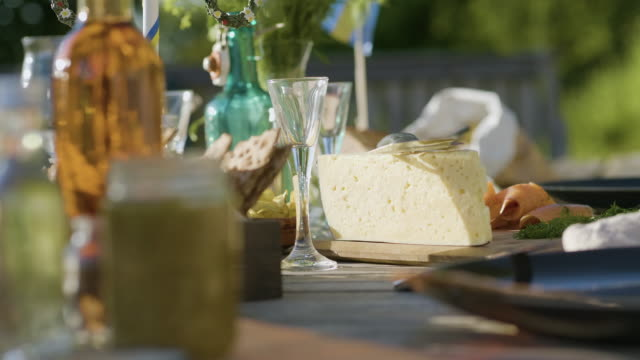 midsummer food on a wooden table - swedish culture stock videos & royalty-free footage