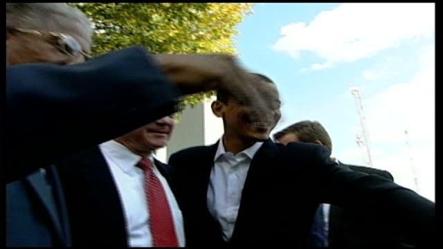 campaigning **Barack Obama interview partly overlaid** Obama posing with Jim Webb
