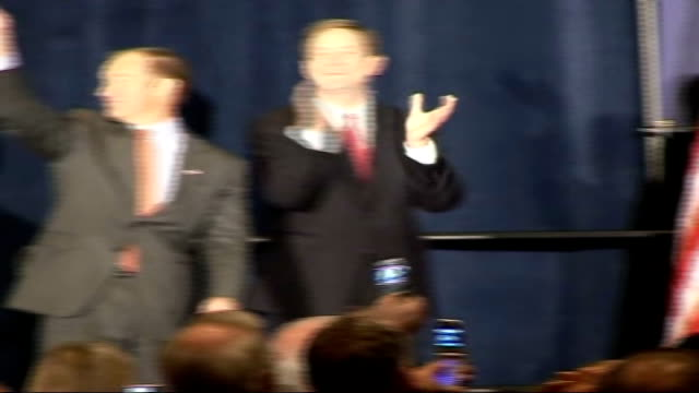 campaigning; laura bush introduces peter roskam at republican rally, roskam waves from stage roskam meeting worker in warehouse peter roskam... - laura bush stock videos & royalty-free footage