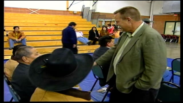 final campaigning on eve of polling day montana jon tester shaking hands with voters gathered for rally in sports hall - political rally stock videos & royalty-free footage