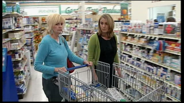 rise of the tea party movement reporter to camera kentucky middlesboro int reporter going around supermarket with sally shook as shops for poor... - tea party stock videos and b-roll footage