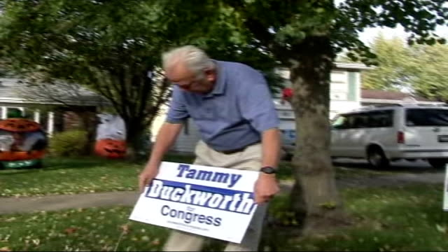 tammy duckworth campaign in illinois; bob starvel with tammy duckworth election poster bob starvel interview sot - midterm election stock videos & royalty-free footage