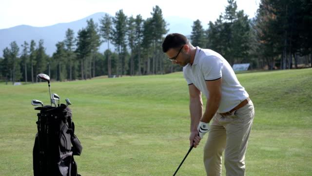 mid-thirties golfer teeing off - golf bag stock videos & royalty-free footage