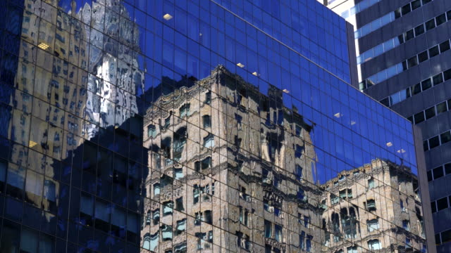 midtown manhattan buildings reflect to the building surface at front in new york. - midtown manhattan stock videos & royalty-free footage