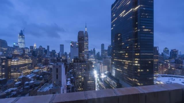 midtown manhattan night to day time lapse - new york city penn station stock videos & royalty-free footage
