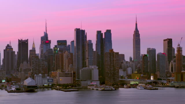 midtown manhattan skyline along the hudson river on an early, clear morning. - chrysler building stock-videos und b-roll-filmmaterial