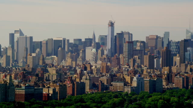 wide aerial pan of midtown manhattan skyline from central park - citigroup center manhattan stock videos & royalty-free footage