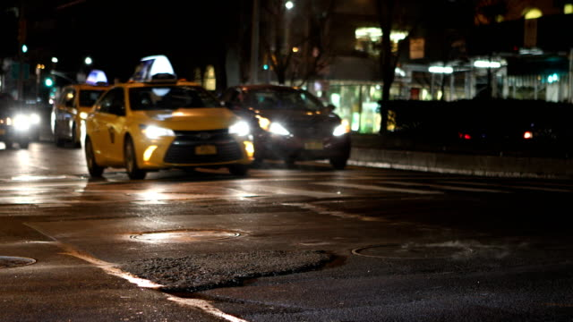 midtown manhattan streets at night - yellow taxi stock videos and b-roll footage