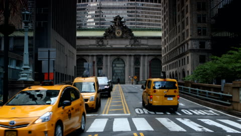 midtown manhattan traffic in motion - taxi stock videos & royalty-free footage
