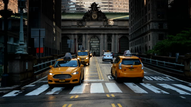 midtown manhattan traffic in wet streets - yellow taxi stock videos & royalty-free footage