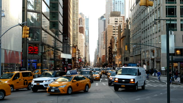 midtown manhattan traffic scene - taxi stock videos & royalty-free footage