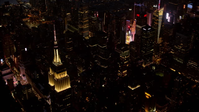 aerial midtown manhattan with chrysler building and times square at night - chrysler building stock videos & royalty-free footage