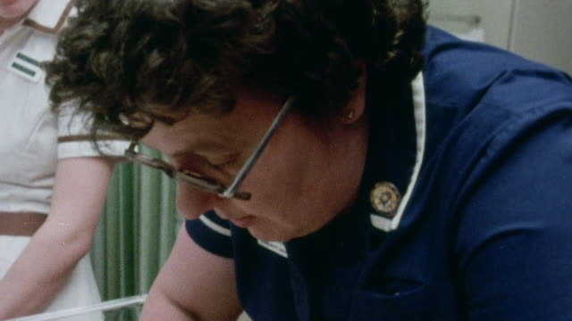 1982 montage midwife performing postnatal examination of newborn and returning the infant to the mother / oxford, oxfordshire, england - 1982 stock videos and b-roll footage