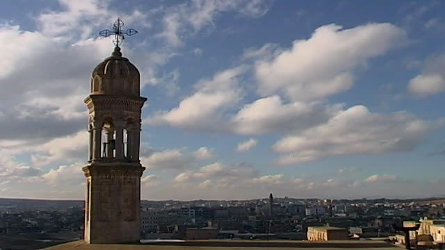 midyat, turkey. wide shot, general view of the town showing church steeple. - steeple stock videos & royalty-free footage