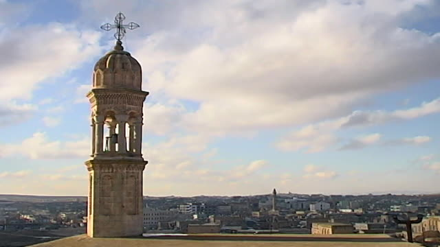 midyat turkey wide shot general view of the town showing church steeple - steeple stock videos & royalty-free footage