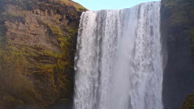 SLO MO TD Mighty Skogafoss waterfall in Iceland