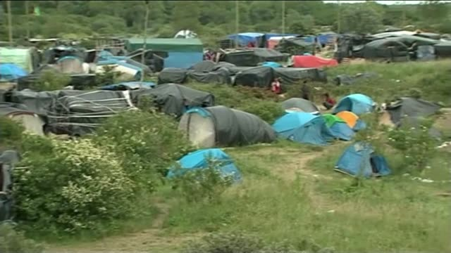 migrant camp 'the jungle' in calais migrants along by tents makeshift camp migrants washing isabelle bruand interview sot - makeshift stock videos and b-roll footage