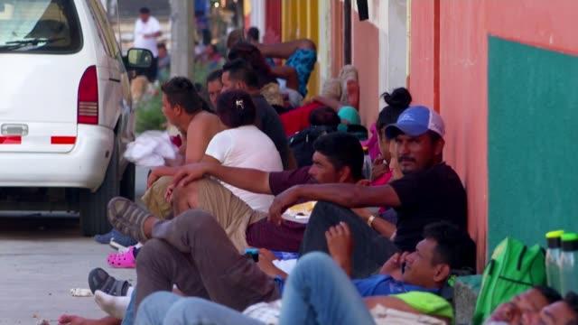 migrant caravan travels from chiapas to oaxaca; mexico, chiapas-oaxaca; merlin orellana interview, two men playing guitars and singing in street,... - pavement点の映像素材/bロール