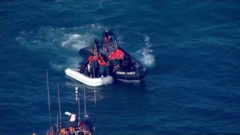 migrant channel crossings: nine migrants cross from calais to dover; english channel: ext air view migrants in dinghy alongside british border force... - english channel stock videos & royalty-free footage