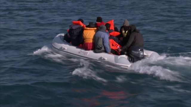 migrant channel crossings: nine migrants cross from calais to dover; english channel: ext reporter on boat looking at migrants on dinghy migrants on... - refugee stock videos & royalty-free footage