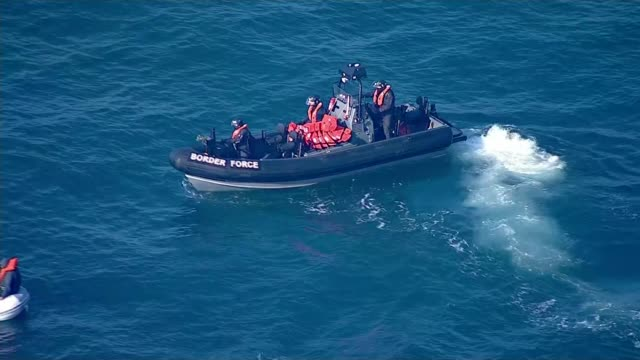 nine migrants cross from calais to dover english border force rib turning and along towards migrants' dinghy - english channel stock videos & royalty-free footage