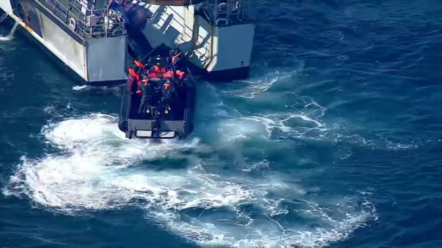 nine migrants cross from calais to dover english border force rib with migrants coming aboard border force boat 'vigilant' - english channel stock videos & royalty-free footage