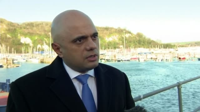 sajid javid claims migrants may not be 'genuine' asylum seekers on dover visit england kent dover ext sajid javid mp interview sot the question has... - parlamentsmitglied stock-videos und b-roll-filmmaterial