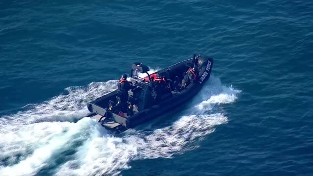 uk border force migrant rescue aerials england kent dover uk border forces rescuing suspected migrants from dinghy boat and taking them to port of... - refugee stock videos & royalty-free footage
