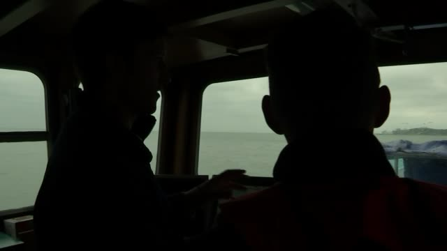 2 british men accused of immigration offences after migrant boat picked up in english channel england kent dymchurch shot forward from boat moving... - sea channel stock videos and b-roll footage