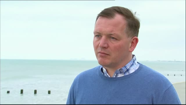 vídeos de stock e filmes b-roll de damian collins interview in dymchurch; england: kent: dymchurch: ext damian collins mp interview sot collins along / collins looking out to sea at... - mp