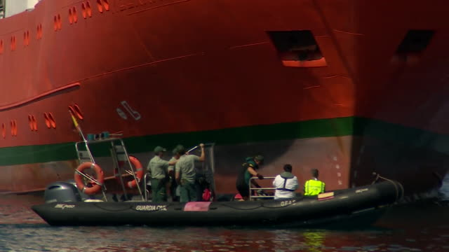 Migrants aboard the ship Aquarius arriving in Spain after being refused entry to Italy and Malta