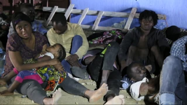 Migrants are seen at migrants shelter in Tripoli after they were captured by coast guard while they were trying to pass illegally to Europe from Gasr...