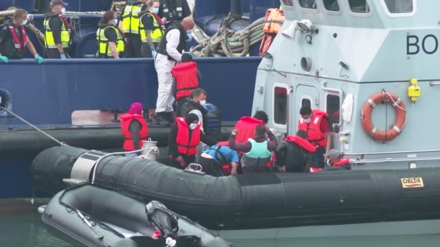migrants arrive in port aboard a border force vessel after being intercepted while crossing the english channel from france in small boats on august... - kent england stock videos & royalty-free footage