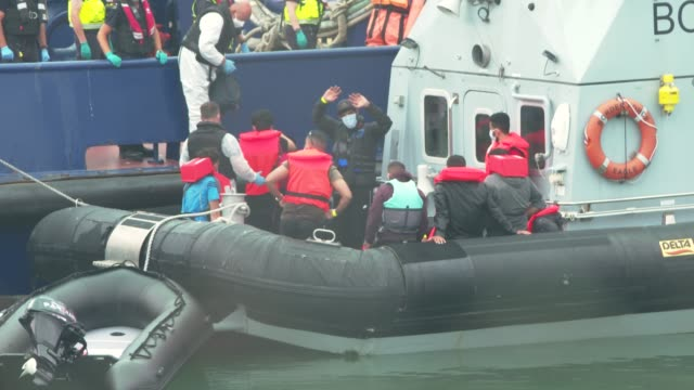 migrants arrive in port aboard a border force vessel after being intercepted while crossing the english channel from france in small boats on august... - emigration and immigration stock videos & royalty-free footage