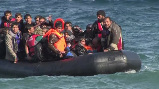 migrants arriving on the greek island on lesbos on saturday where welcomed by volunteers as they came off boats from turkey - greece stock videos & royalty-free footage