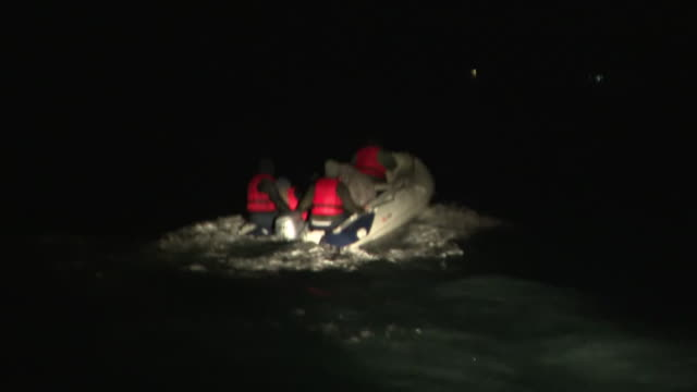 migrants attempting to cross the english channel in a motorised dinghy before being picked up by an rnli boat - english channel stock videos & royalty-free footage