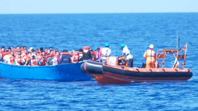 migrants being rescued from the mediterranean by a rescue ship - mittelmeer stock-videos und b-roll-filmmaterial