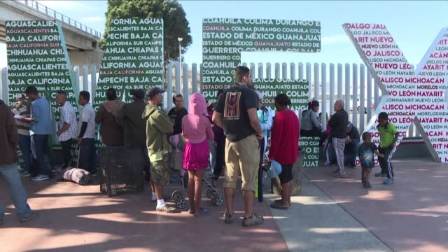 migrants belonging to the central american caravan begin asking for asylum at the border in tijuana mexico as many others continue to arrive at... - baja california norte stock videos & royalty-free footage