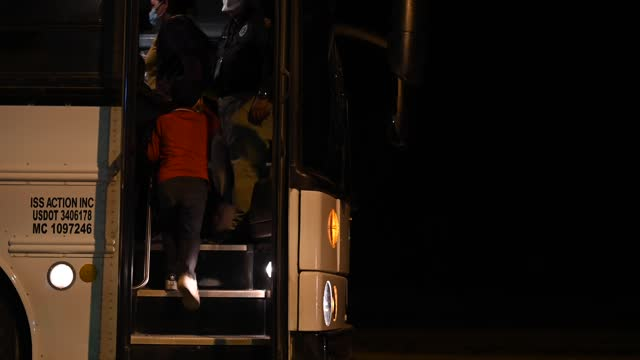 migrants board a bus to be taken to a border patrol processing facility after crossing the rio grande into the u.s. on june 21 in la joya, texas. a... - mcallen texas stock videos & royalty-free footage