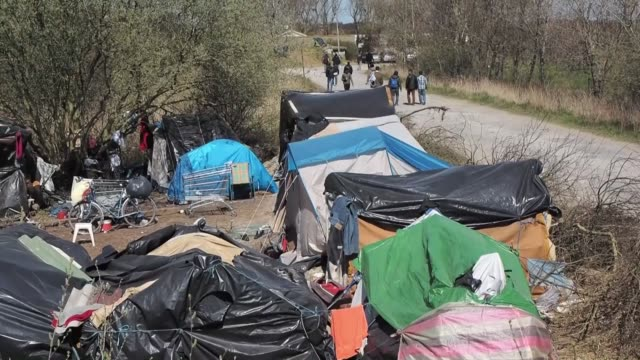 Migrants camped out in Calais try to make tent using woods in Calais France on April 18 2015 More than 2 thousands migrants mainly from Afghanistan...