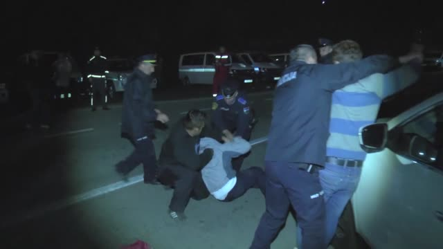 migrants continue their waiting at the border between bosnia and croatia after clashed with bosnian police while trying to cross the border near... - bosnia and hercegovina stock videos & royalty-free footage