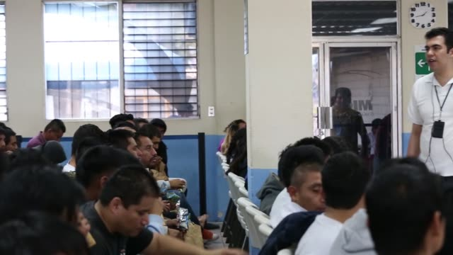 migrants deported from the us and northern mexico sit in the processing center of an air force base in guatemala city guatemala on friday dec 18 2015... - 中央アメリカ点の映像素材/bロール