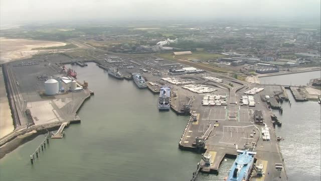migrants exploit calais port strike air view / aerial port of calais ferries docked in port and lorries parked in holding areas - calais stock videos & royalty-free footage