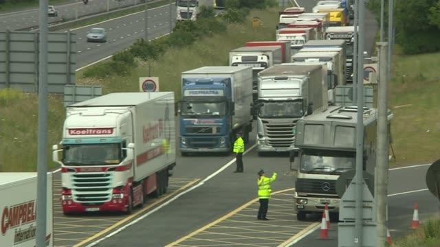 Migrants exploit Calais port strike ENGLAND Kent Folkestone Various of traffic jam of lorries and cars on motorway near Eurotunnel exit / entrance...