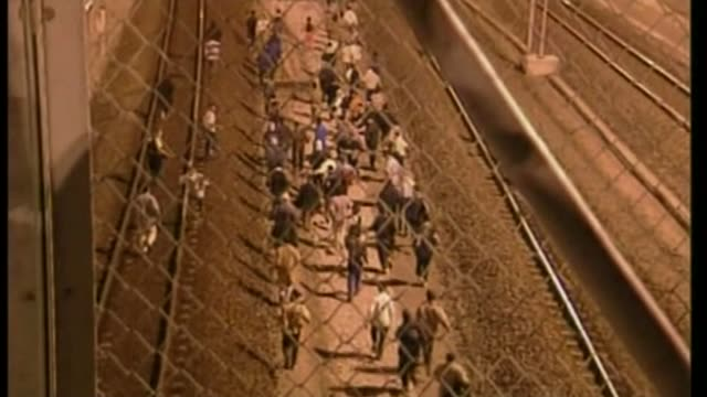 migrants exploit calais port strike lib large group of asylumseekers running thru eurotunnel compound and along rail track as attempt to smuggle... - calais stock videos and b-roll footage